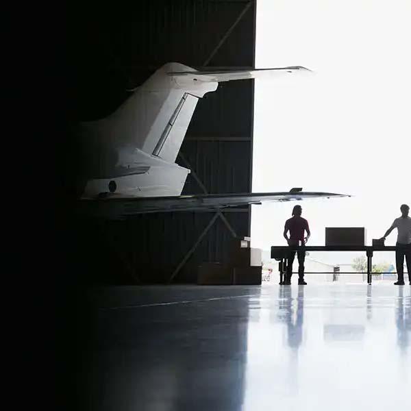 Plane in hanger international shipping