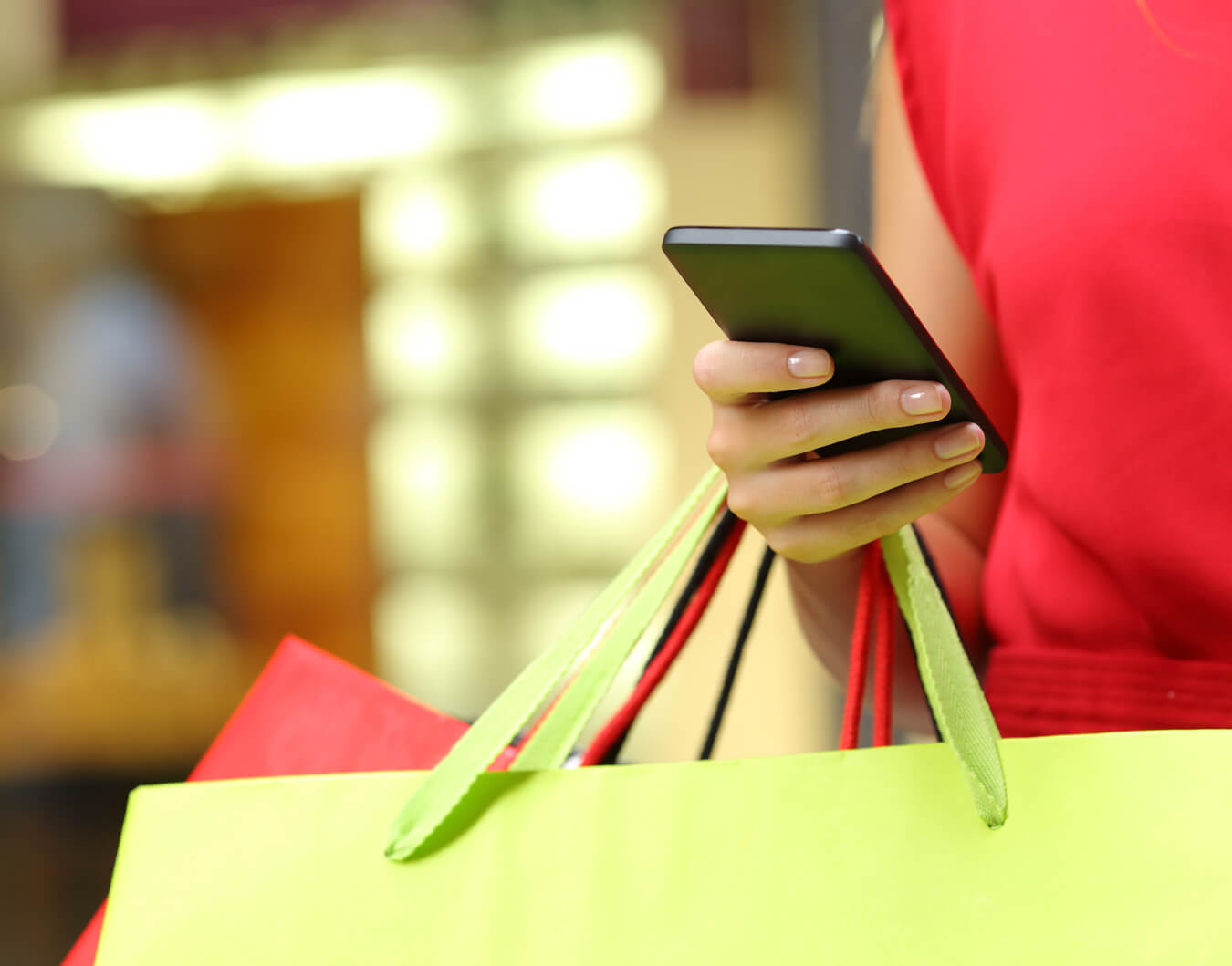 Woman out shopping on mobile device